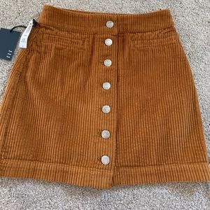 Wilfred button front corduroy mini skirt